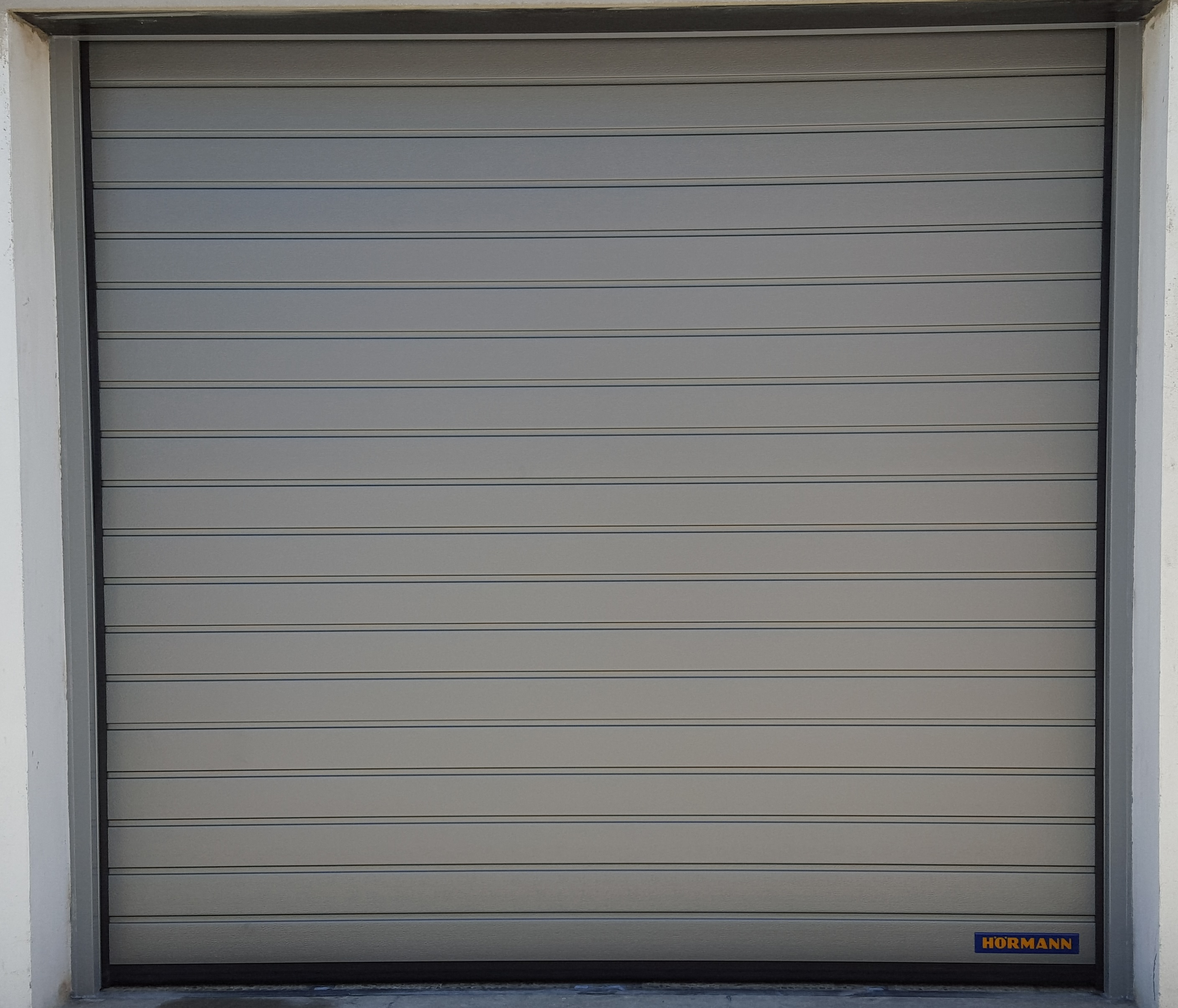 Saint denis porte hormann a m a ile de france for Porte de garage 5m hormann